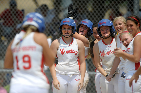 Lindsey Shiels-Brophy, of the Colorado Lady Warriors runs back after completing a home run to home plate and the rest of her team cheering her on at the Louisville Sports Complex Friday afternoon. The Colorado Lady Warriors lost to the Kansas Peppers 9-8. Rachel Woolf/ For the Daily Camera