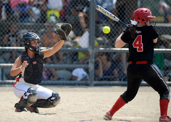 Colorado Lady Warriors catcher Lindsey Shiels-Brophy catches the ball from the pitcher at the Louisville Sports Complex Friday afternoon. The Colorado Lady Warriors lost to the Kansas Peppers 9-8. Rachel Woolf/ For the Daily Camera