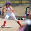 Corin Panozzo, of The Colorado Lady Warriors, attempts to sneak past opponents from the rivaling Kansas Peppers at the Louisville Sports Complex Friday afternoon. The Colorado Lady Warriors lost to the Kansas Peppers 9-8. Rachel Woolf/ For the Daily Camera