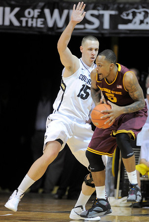 Colorado's Beau Webb (left) blocks Arizona State's Kyle Cain (right) during their basketball game at the University of Colorado in Boulder, Colorado January 19, 2012. CAMERA/MARK LEFFINGWELL