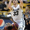 "Austin Dufault of CU drives into Chris Colvin of ASU.<br /> For more photos of the game, go to  <a href=""http://www.dailycamera.com"">http://www.dailycamera.com</a>.<br /> January 19, 2012 / Cliff Grassmick"