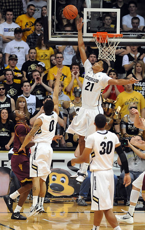 "Andre Roberson of CU goes up to block an ASU shot.<br /> For more photos of the game, go to  <a href=""http://www.dailycamera.com"">http://www.dailycamera.com</a>.<br /> January 19, 2012 / Cliff Grassmick"