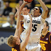 "Spencer Dinwiddie of CU shoots over Max Heller of ASU.<br /> For more photos of the game, go to  <a href=""http://www.dailycamera.com"">http://www.dailycamera.com</a>.<br /> January 19, 2012 / Cliff Grassmick"