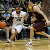 Colorado's Carlon Brown (left) is pressured byArizona State's Ruslan Pateev (right) during their basketball game at the University of Colorado in Boulder, Colorado January 19, 2012. CAMERA/MARK LEFFINGWELL