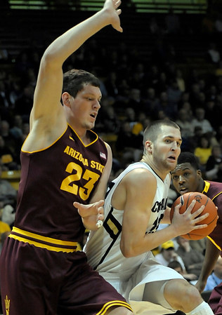 Colorado's Austin Dufault (right) pushes past Arizona State's Ruslan Pateev (left) during their basketball game at the University of Colorado in Boulder, Colorado January 19, 2012. CAMERA/MARK LEFFINGWELL