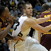 Colorado's Austin Dufault (right) charges for the goal while being guarded by Arizona State's Kyle Cain (left) during their basketball game at the University of Colorado in Boulder, Colorado January 19, 2012. CAMERA/MARK LEFFINGWELL