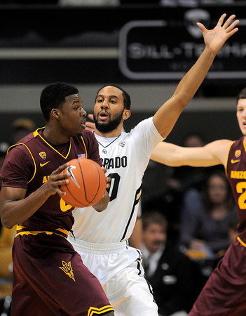 Colorado's Carlon Brown (right) guards Arizona State's Carrick Felix (left) during their basketball game at the University of Colorado in Boulder, Colorado January 19, 2012. CAMERA/MARK LEFFINGWELL