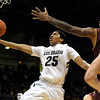 Colorado's Spencer Dinwiddie (left) slides under Arizona State's Kyle Cain for a shot during their basketball game at the University of Colorado in Boulder, Colorado January 19, 2012. CAMERA/MARK LEFFINGWELL
