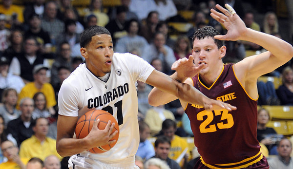 "Andre Roberson of CU drives to the basket past Ruslan Pateev of ASU.<br /> For more photos of the game, go to  <a href=""http://www.dailycamera.com"">http://www.dailycamera.com</a>.<br /> January 19, 2012 / Cliff Grassmick"