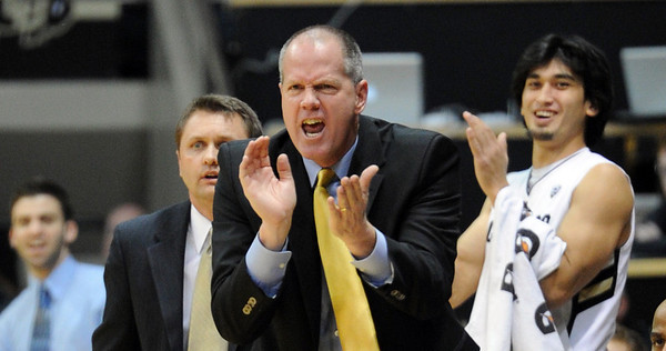 """Tad Boyle, head coach at CU, encourages his players in the ASU game.<br /> For more photos of the game, go to  <a href=""""http://www.dailycamera.com"""">http://www.dailycamera.com</a>.<br /> January 19, 2012 / Cliff Grassmick"""