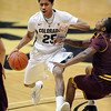 "Spencer Dinwiddie of CU moves Chris Colvin of ASU out of the way.<br /> For more photos of the game, go to  <a href=""http://www.dailycamera.com"">http://www.dailycamera.com</a>.<br /> January 19, 2012 / Cliff Grassmick"