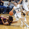 "Nate Tomlinson of CU gets rolled up on by Jordan Bachynski of ASU.<br /> For more photos of the game, go to  <a href=""http://www.dailycamera.com"">http://www.dailycamera.com</a>.<br /> January 19, 2012 / Cliff Grassmick"