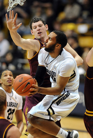 "Carlon Brown of CU drives to the basket past Ruslan Pateev  of ASU.<br /> For more photos of the game, go to  <a href=""http://www.dailycamera.com"">http://www.dailycamera.com</a>.<br /> January 19, 2012 / Cliff Grassmick"
