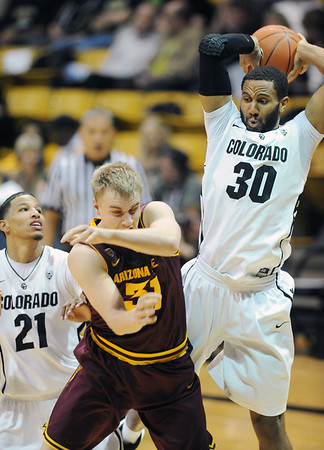"Carlon Brown of CU gets a rebound over Jonathan Gilling of ASU.<br /> For more photos of the game, go to  <a href=""http://www.dailycamera.com"">http://www.dailycamera.com</a>.<br /> January 19, 2012 / Cliff Grassmick"