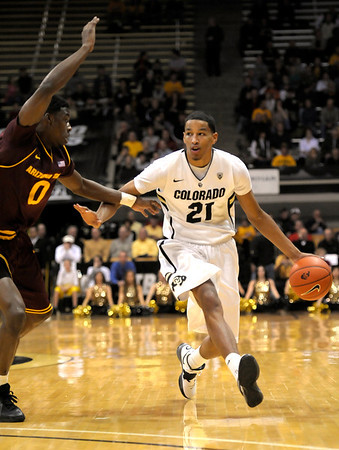 Colorado's Andre Roberson (right) looks to get past Arizona State's Carrick Felix (left) during their basketball game at the University of Colorado in Boulder, Colorado January 19, 2012. CAMERA/MARK LEFFINGWELL