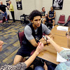 "University of Colorado player, Askia Booker talks to reporters,  during media day  on October 18, 2012.<br /> For more photos and videos of media day, go to  <a href=""http://www.dailycamera.com"">http://www.dailycamera.com</a>.<br /> Cliff Grassmick / October 18, 2012"