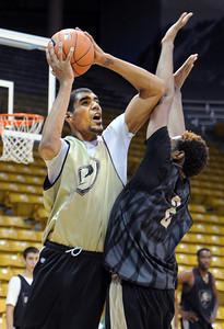University of Colorado player, Josh Scott shoots over Xavier Johnson,  during media day practice on October 18, 2012. For more photos and videos of media day, go to www.dailycamera.com. Cliff Grassmick / October 18, 2012