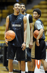University of Colorado players, Spencer Dinwiddie, left. Chris Jenkins and Askia Booker,  during media day practice on October 18, 2012. For more photos and videos of media day, go to www.dailycamera.com. Cliff Grassmick / October 18, 2012