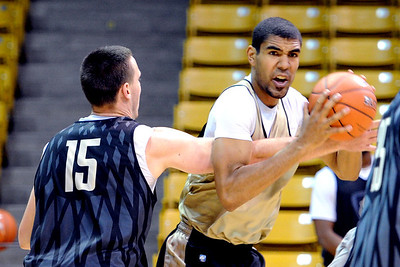 University of Colorado players, Shane Harris-Tunks guarding Josh Scott,  during media day practice on October 18, 2012. For more photos and videos of media day, go to www.dailycamera.com. Cliff Grassmick / October 18, 2012