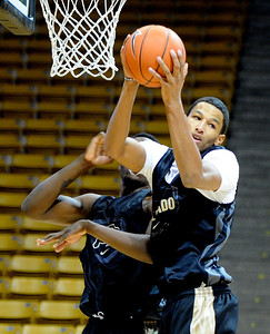 University of Colorado player, Andre Roberson rebounds  during media day practice on October 18, 2012. For more photos and videos of media day, go to www.dailycamera.com. Cliff Grassmick / October 18, 2012