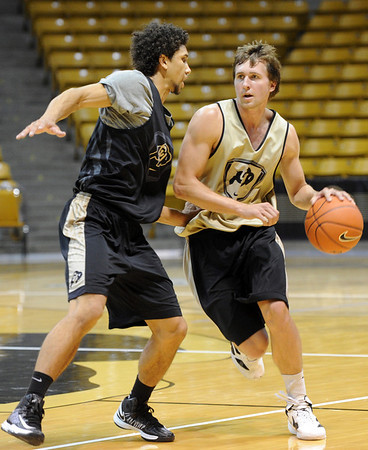 "University of Colorado player, Eli Stalzer drives on Askia Booker,  during media day practice on October 18, 2012.<br /> For more photos and videos of media day, go to  <a href=""http://www.dailycamera.com"">http://www.dailycamera.com</a>.<br /> Cliff Grassmick / October 18, 2012"