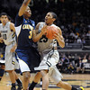 Spencer Dinwiddie of CU drives into Tyrone Wallace of Cal during the first half of the January 27th, 2013 game in Boulder.<br /> Cliff Grassmick / January 27, 2013