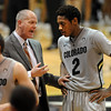 CU Coach Tad Boyle talks to Xavier Johnson during the second  half of the January 27th, 2013 game in Boulder.<br /> Cliff Grassmick / January 27, 2013