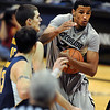 Andre Roberson goes strong to the basket past David Kravish of Cal during the second  half of the January 27th, 2013 game in Boulder.<br /> Cliff Grassmick / January 27, 2013