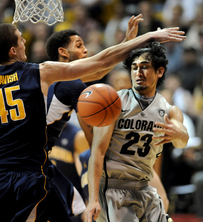 Sabatino Chen of CU passes around David Kravish of Cal during the second  half of the January 27th, 2013 game in Boulder.<br /> Cliff Grassmick / January 27, 2013