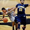 Allen Crabbe (23) of Cal, slams into Spencer Dinwiddie of CU  for the foul during the second  half of the January 27th, 2013 game in Boulder.<br /> Cliff Grassmick / January 27, 2013