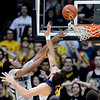 Xavier Johnson of CU goes to the basket on Robert Thurman of Cal during the first half of the January 27th, 2013 game in Boulder.<br /> Cliff Grassmick / January 27, 2013