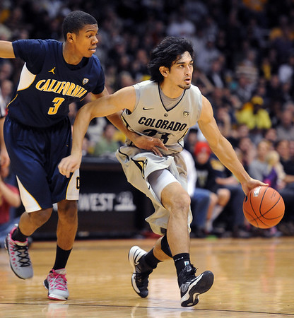 Sabatino Chen of CU drives around Tyrone Wallace of Cal during the first half of the January 27th, 2013 game in Boulder.<br /> Cliff Grassmick / January 27, 2013