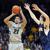 Andre Roberson of CU shoots past David Kravish of Cal during the first half of the January 27th, 2013 game in Boulder.<br /> Cliff Grassmick / January 27, 2013