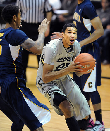 Andre Roberson of CU drives on Richard Solomon of Cal during the second half of the January 27th, 2013 game in Boulder.<br /> Cliff Grassmick / January 27, 2013