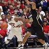 Arizona's Kyle Fogg dribbles around Carlon Brown. (AP Photo/Wily Low)