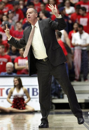 Colorado Buffaloes coach Tad Boyle signals in a play during Thursday's game vs. the Arizona Wildcats at the McKale Center in Tucson, Ariz. (AP Photo/Wily Low)