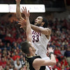 Arizona's Jesse Perry shoots over Andre Dufault. (AP Photo/Wily Low)