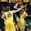 Colorado's Carlon Brown, center, passes the ball out from the paint under pressure from Oregon's Jeremy Jacob, left, E.J. Singler and Carlos Emory during the second half of an NCAA college basketball game Thursday March 1, 2012 in Eugene, Ore. (AP Photo/Chris Pietsch)