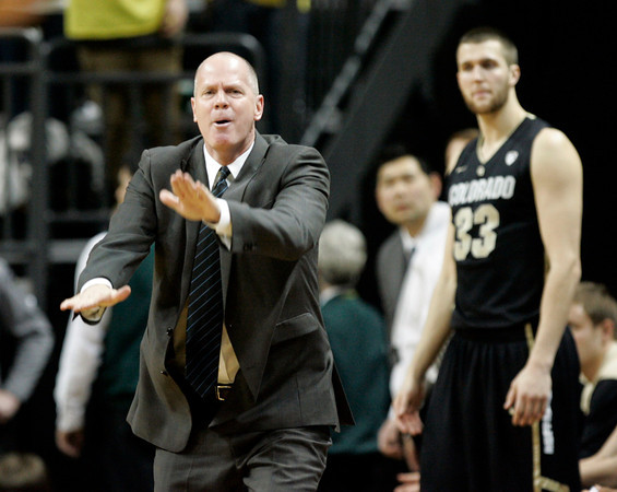 Colorado Head Basketball Coach Tad Boyle, left, looks for a travel call against Oregon from the refs as player Austin Dufault looks on during the second half of an NCAA college basketball game Thursday March 1, 2012 in Eugene, Ore. (AP Photo/Chris Pietsch)