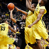 Colorado's Spencer Dinwiddie (25) shoots while fouled as he drives between Oregon's Carlos Emory (33),  Olu Ashaolu and Tyrone Nared during the first half of an NCAA college basketball game, Thursday, March 1, 2012, in Eugene, Ore. (AP Photo/Chris Pietsch)