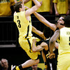 Oregon's Garrett Sim (3) is fouled as he drives to the basket against Colorado's Nate Tomlinson and Shane Harris-Tunks during the first half of an NCAA college basketball game, Thursday, March 1, 2012, in Eugene, Ore. (AP Photo/Chris Pietsch)