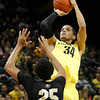 Oregon's Devoe Joseph, right, goes up for a 3 point shot over Colorado's Spencer Dinwiddie during the second half on his way to a game high 24 points in an NCAA college basketball game Thursday March 1, 2012 in Eugene, Ore. (AP Photo/Chris Pietsch)