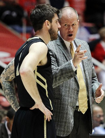 Colorado head coach Tad Boyle gives guard Nate Tomlinson instructions during a break in the action. (AP)