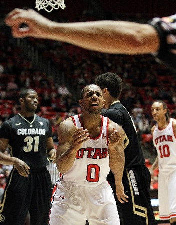 Utah's Chris Hines appeals to the official after being called for a charge during the second half of Saturday's game. (AP)