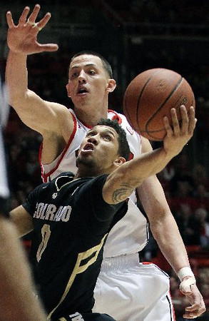 Colorado freshman Askia Booker puts up a shot against Utah's Jason Washburn. (AP)