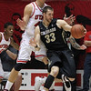 Colorado's Austin Dufault is defended by Utah's Jason Washburn. (AP)