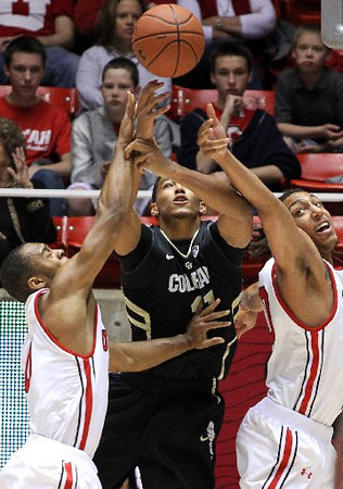 CU Buffs forward Andre Roberson battles for a loose ball with Utah Utes players Chris Hines, left, and Dijon Farr during Saturday's game in Salt Lake City. (AP)