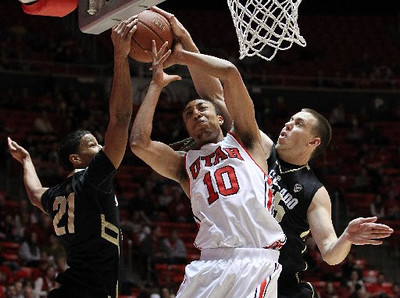 Utah forward Dijon Farr is surrounded by Colorado's Andre Roberson, left, and Shane Harris-Tunks. (AP)