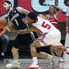 Colorado's Nate Tomlinson is fouled by Utah's Kareem Storey. (AP)