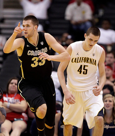 P12 Colorado California(7).JPG Colorado's Austin Dufault, left, makes his way past California's David Kravish after making a basket during the first half of an NCAA college basketball game in the semifinals of the Pac-12 conference championship in Los Angeles, Friday, March 9, 2012. (AP Photo/Jae C. Hong)